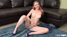 Fiery redhead Marie McCray does a suggestive striptease and shows off