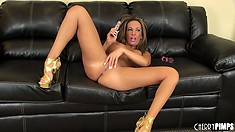 Richelle Ryan lays back to fuck herself in a pair of high heels
