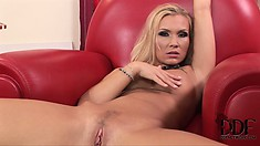 Sexy blonde MILF slips out of her skirt and slips her fingers in her slit