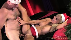Erica Lauren causes her Santa to shoot his load in her pussy making her cum