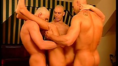 Three bald headed guys take turns fucking a young stud's tight anal hole