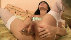 Curvaceous nurse in sexy fishnets loves the taste of her pussy