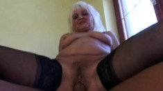 Busty blonde in fishnets opens her legs for a rock hard cock