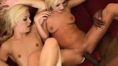 Two blonde bombshells feed their hungry holes a massive black cock