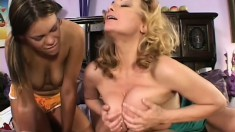 Naughty college girl strokes her friend's clit while she rides a fat cock