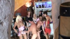 Big breasted tart gets all her holes drilled at a steaming hot bar orgy