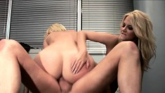 Two busty blonde secretaries take turns fucking a cock in the office