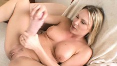 Buxom blonde Harmony deeply drills her aching peach with big dildos