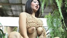 Big breasted Oriental cutie Kate Bong pleases her twat with a sex toy