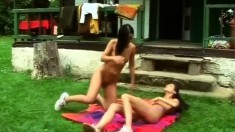 Ravishing brunettes indulge in steamy lesbian action in the outdoors