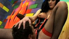 Mistress Leah Wilde ties up her slave and steps all over him
