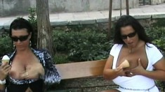 Stacked BFFs Aneta Buena and Kora roam around town with their tits exposed and stop to piss in the sea
