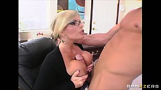 Busty blonde boss wants his cock and blows and titty fucks his big boner