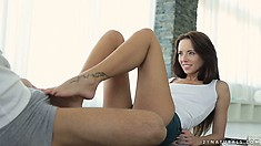 Brunette sweetie with sexy tattooed feet teases his raging boner