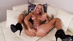 Blonde slut teases her clit while fisting away at her snatch