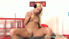 Skinny blonde Lena Love gets undressed and sticks her fingers in and pumps