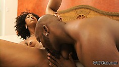 Curly haired ebony gets woken up for some hot, morning pussy licking