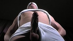 Uninhibited young stunner gets tied up and jerked off until he cums