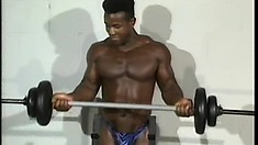Horny black guy lifts some weights and then strokes his cock until he cums