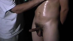 Skinny initiate gets fingered and jerked off while wearing a blindfold