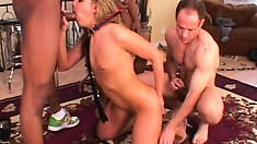 Slender blonde has three guys fucking her throat with their long cocks