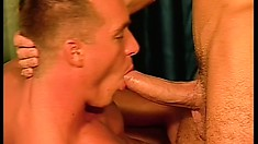 Muscled stud strokes his own prick while his gay lover drills his ass