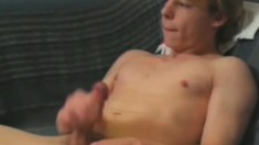 Handsome young man Lenny strokes up and down his meaty boner