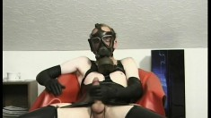 Bizarre solo dude in a gas mask jerks his long throbbing member