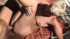 Short haired blonde plays with sex toys before enjoying a black cock