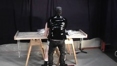 Butch dude endures some rough plastic punishment from latex master