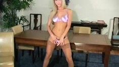 Wonderful blonde Sammie puts on display the sexy contours of her body