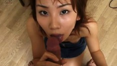 Naughty Japanese housewife drops to her knees and worships a fat dick