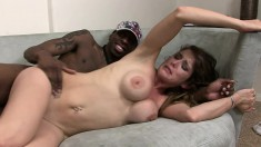 Busty brunette Felony gets humped by a black cock and licks up his cum