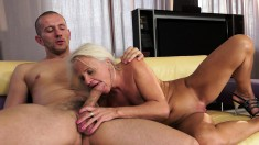 Blonde granny gets her hot pussy worked with fingers and toys