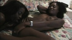 Sultry black babes Monique and Kaire enjoying lesbian sex on the bed