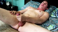 Sexy stud Mike Honcho lies naked on the bed and strokes his big stick