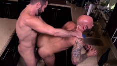 Bald headed stud and his sexy gay lover fuck each other in the kitchen