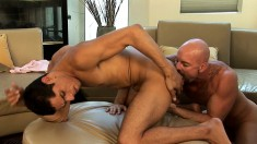 Hot young stud gives and receives oral and anal sex from an older guy
