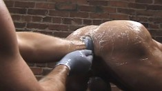 Hard cocks are swallowed and lubed asses are fisted in a wild all-male orgy in an alley