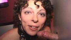 Slutty brunette nympho on a leash kneels down and sucks off strangers