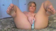 Horny MILF teacher toys her wet muf
