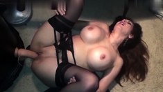 Sexy brunette babe in lingerie and stockings toys pussy